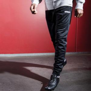 Model wears uhlsport Essential Performance Pants Black