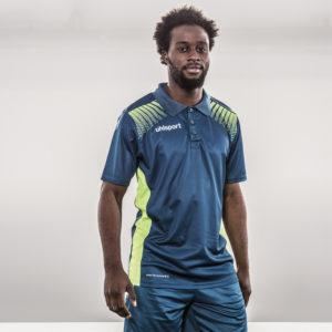 Model wears uhlsport Goal Polo Shirt Petrol Flash Green