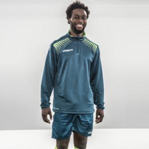 Model wears uhlsport Goal Quarter Zip Top Petrol Flash Green
