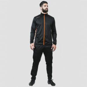 Model wears uhlsport Essential Tracksuit Black Fluo Orange