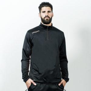 Model wears uhlsport Essential Quarter Zip Top Black White