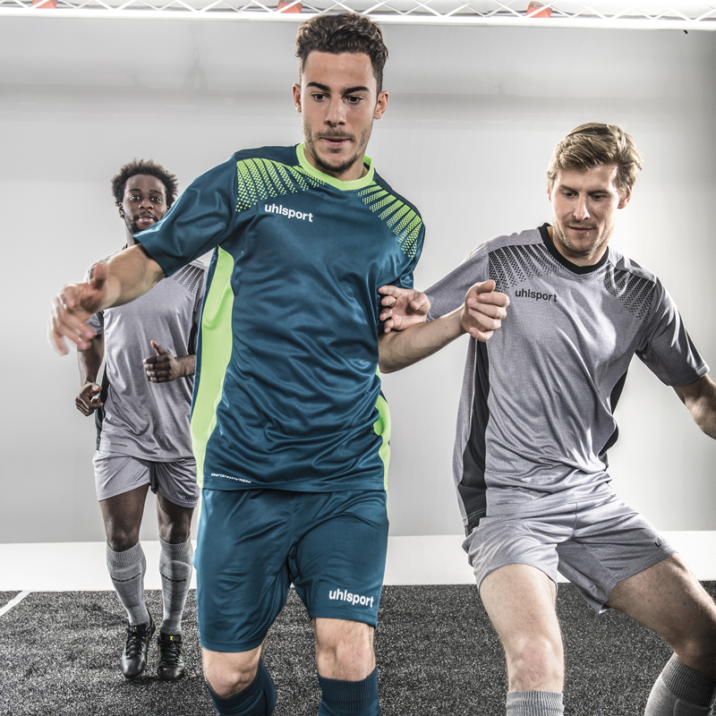 Model wears uhlsport Goal Shirt and Shorts Petrol Flash Green