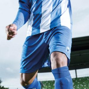 Model wears uhlsport Centre Basic II Shorts Azure Blue